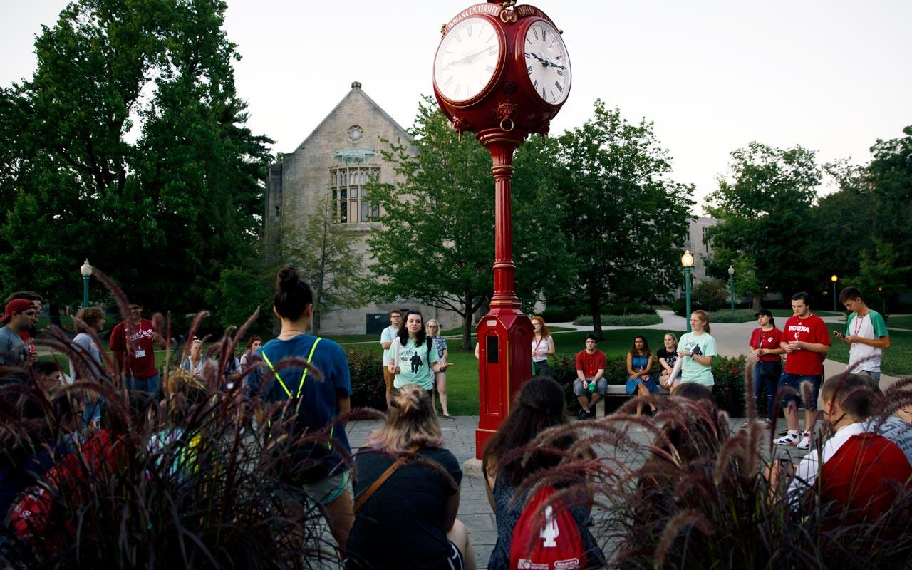 IU Bloomington students at orientation standing by a clock tower.