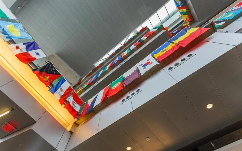 Flags of many nations hanging in atrium at IUPUI.