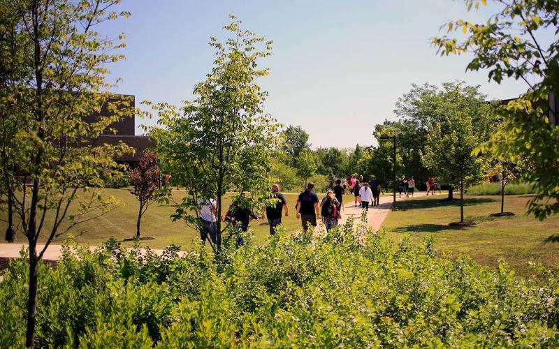 Students walking across the IU East campus.