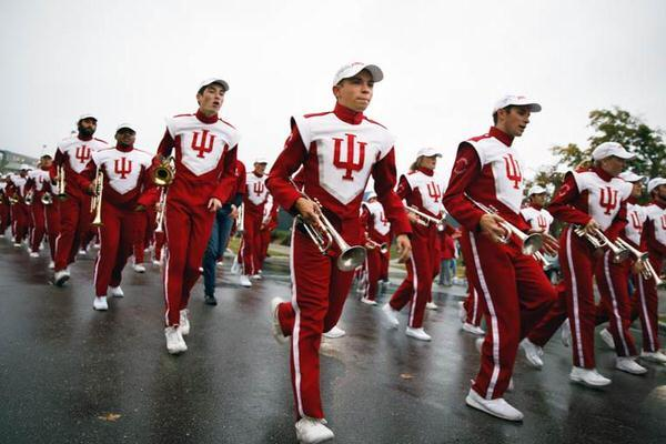 Marching band performing in a parade at IU Bloomington.