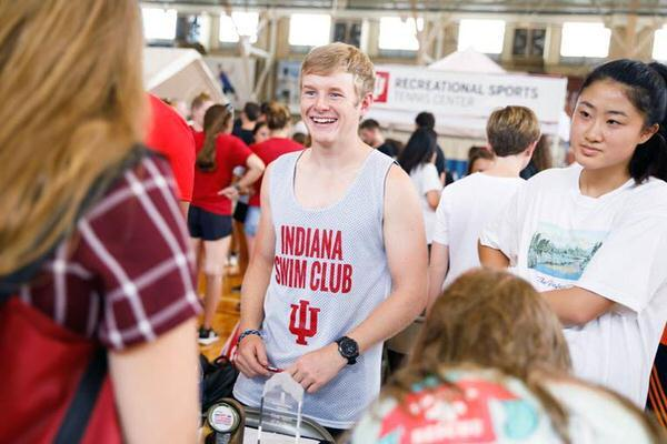 Male student at a student organization fair on the IU Bloomington campus.
