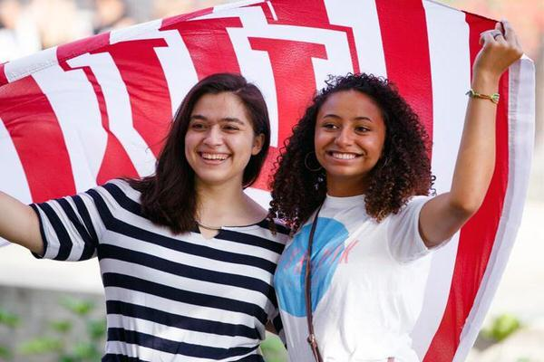 Two female students holding an IU flag.