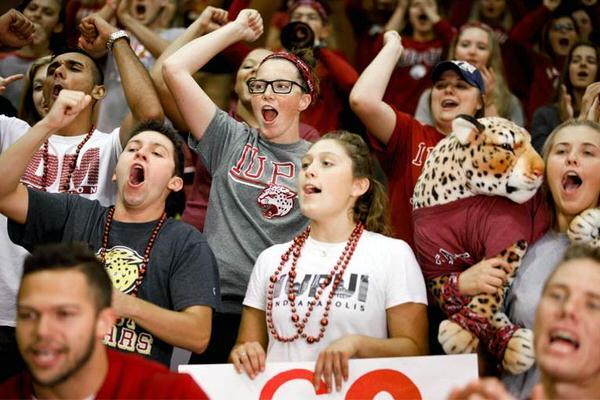 Crowd of students cheering at an IUPUI basketball game.