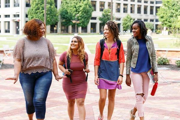 Group of female undergraduate students walking on IUPUI's campus.